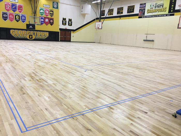 Gym floor taped for painting